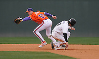 Second baseman Steve Wilkerson (17) of the Clemson Tigers reaches for the ball to make the putout on Dante Rosenberg in a game against the South Carolina Gamecocks on Saturday, March 2, 2013, at Fluor Field at the West End in Greenville, South Carolina. Clemson won the Reedy River Rivalry game 6-3. (Tom Priddy/Four Seam Images)