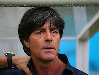 Germany coach Joachim Loew as rain drops from the dugout above him