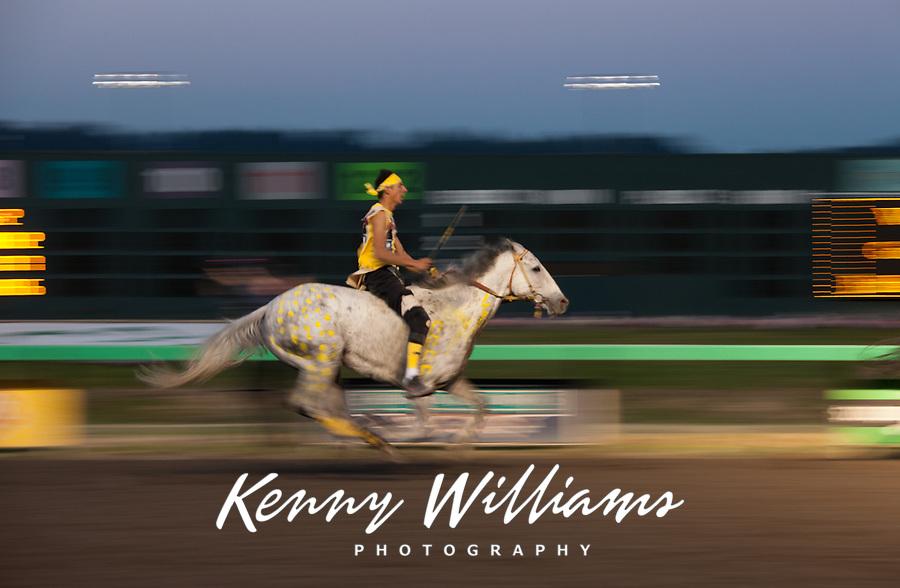 Chaz Racine Riding Yellow Painted Grey Horse, Team Carson, Battle of Horse Nation, Indian Horse Relay Racing, Emerald Downs, Auburn, Washington, WA, America, USA.