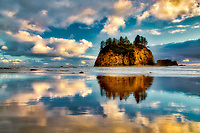 Low tide reflection of Crying Lady Rock at Second Beach. Olympic National Park, Washington