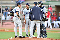 Pulaski Yankees third baseman Andres Chaparro (18), starting pitcher Carlos Espinal (35), pitching coach Gerardo Casadiego (53) and catcher Victor Rey (43) have a discussion on the mound during a game against the Elizabethton Twins at Joe O'Brien Field on June 27, 2016 in Elizabethton, Tennessee. The Yankees defeated the Twins 6-4. (Tony Farlow/Four Seam Images)