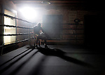 Pro boxer Bernard Hopkins rests during practice in Los Angeles. Hopkins' trainer Freddie Roach is convinced that boxing gave him Parkinson's disease, but there is no bitterness when he speaks of how he regrets not ending his fighting career earlier than he did.  Boxing lifted him from dead-end jobs in Las Vegas after 10 years as a professional fighter left him broke.