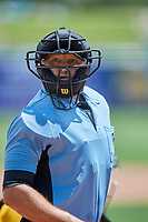 Umpire Justin Robinson handles the calls behind the plate during the game between the Salt Lake Bees and the Las Vegas Aviators at Smith's Ballpark on June 27, 2021 in Salt Lake City, Utah. The Aviators defeated the Bees 5-3. (Stephen Smith/Four Seam Images)