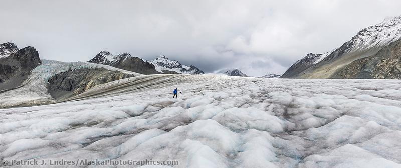 Hikers travel along the Gulkana Glacier in the Alaska Range mountian.