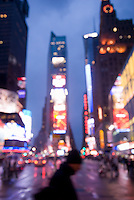 AVAILABLE FROM JEFF AS A FINE ART PRINT.<br /> <br /> AVAILABLE DIRECTLY FROM JEFF FOR COMMERCIAL AND EDITORIAL LICENSING.<br /> <br /> Soft Focus/Defocussed view of Times Square at Dusk, with man crossing street in the foreground, Midtown Manhattan, New York City, New York State, USA