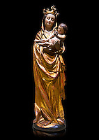 Gothic wooden statue of Madonna and Child from Bohemia, circa 1530-1540, tempera and gold leaf on wood,.  National Museum of Catalan Art, Barcelona, Spain, inv no: MNAC  65506. Against a black background.