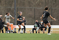 LOUISVILLE, KY - MARCH 13: Emily Fox #11 of Racing Louisville FC maintains control of the ball over Isabella Sibley #19 of West Virginia University during a game between West Virginia University and Racing Louisville FC at Thurman Hutchins Park on March 13, 2021 in Louisville, Kentucky.