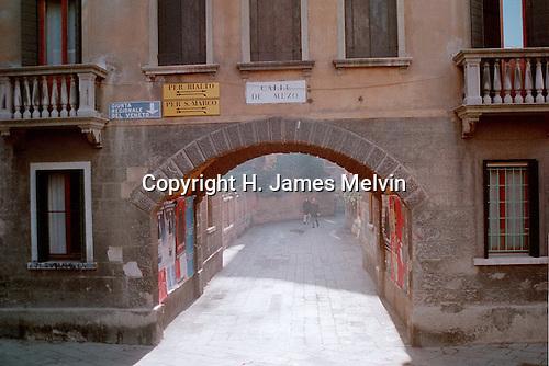 An open passageway to a narrow Venician artery.