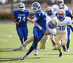 Carson's Asa Carter runs against Reed's Ty Roberts during the NIAA D-1 Northern Regional title game at Bishop Manogue High School in Reno, Nev., on Saturday, Nov. 29, 2014.<br /> Photo by Cathleen Allison