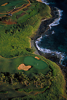 Aerial of golf course with ocean on the island of Kauai