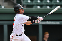 Shortstop Ryan Hagan (3) of the Mercer Bears hits a home run in a game against the VMI Keydets as part of the Southern Conference Championship series on Wednesday, May 24, 2017, at Fluor Field at the West End in Greenville, South Carolina. Mercer won, 11-6. (Tom Priddy/Four Seam Images)