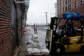 Brooklyn, New York<br /> August 28, 2011<br /> <br /> Brooklyn the morning after (hurricane) tropical storm Irene past over New York. <br /> <br /> Flood streets in Red Hook as people come out to see the damage. A wind tunnel races from the Hudson Bay into Red Hook.