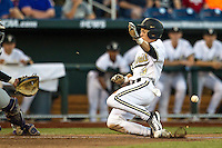 Vanderbilt Commodores outfielder Jeren Kendall (3) slides home against the TCU Horned Frogs in Game 12 of the NCAA College World Series on June 19, 2015 at TD Ameritrade Park in Omaha, Nebraska. The Commodores defeated TCU 7-1. (Andrew Woolley/Four Seam Images)