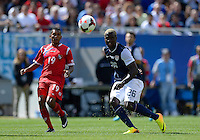 Chicago, IL - Sunday July 28, 2013:   United States forward Eddie Johnson (26) crosses the ball during the CONCACAF Gold Cup Finals soccer match between the USMNT and Panama, at Soldier Field in Chicago, IL.