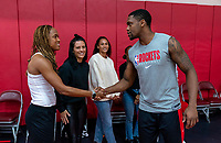 HOUSTON, TX - FEBRUARY 1: Jess McDonald #14 of the United States shakes hands with Michael Frazier of the Houston Rockets at Houston Rockets Training Center on February 1, 2020 in Houston, Texas.