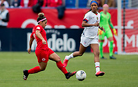 CARSON, CA - FEBRUARY 9: Desiree Scott #11 of Canada passes off the ball during a game between Canada and USWNT at Dignity Health Sports Park on February 9, 2020 in Carson, California.