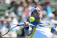 MELBOURNE, AUSTRALIA - JANUARY 10: PAUL-HENRI MATHIEU (FRA) in action against SIMONE BOLLELLI (ITA) on day 2 of the 2013 AAMI Classic event at the Kooyong Lawn Tennis Club in Melbourne, Australia.