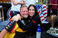 Mar. 30, 2012; Las Vegas, NV, USA: NHRA funny car drivers Alexis DeJoria (right) with teammate Jeff Arend during qualifying for the Summitracing.com Nationals at The Strip in Las Vegas. Mandatory Credit: Mark J. Rebilas-