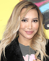 "13 July 2020 - Naya Rivera, the actress best known for playing cheerleader Santana Lopez on Glee, has been confirmed dead. Rivera, 33, is believed to have drowned while swimming in the lake with her 4-year-old son, who was found asleep on their rental pontoon boat after it was overdue for return. 02 February 2019 - Westwood, California - Naya Rivera. ""The LEGO® Movie 2: The Second Part"" Los Angeles Premiere held at Regency Village Theatre. Photo Credit: PMA/AdMedia"