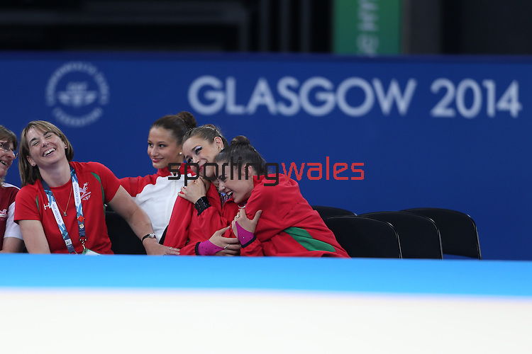 Glasgow 2014 Commonwealth Games<br /> <br /> Celebrations start as coach Jo Coombs and team mate Laura Halford realise Francesca Jones has won gold in the women's Individual Rhythmic Gymnastics Apparatus Final.<br /> <br /> 25.07.14<br /> ©Steve Pope-SPORTINGWALES