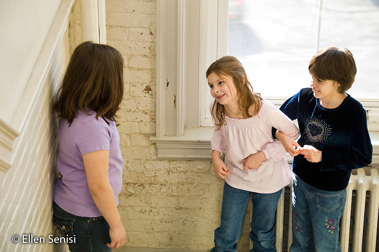MR / Schenectady, New York. Elmer Avenue School (urban public school). 3rd grade classroom. Two students interact together while a third student is excluded. (All students: girls, age 8; girl in dark blue shirt: PDD / Provisional Aspergers). MR: But2, Mit10, Sim8. ID: AH-FRD. ©Ellen B. Senisi.