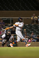 Scottsdale Scorpions center fielder Ronnie Dawson (4), of the Houston Astros organization, follows through on his swing in front of catcher Daulton Varsho (8) during an Arizona Fall League game against the Salt River Rafters at Salt River Fields at Talking Stick on October 11, 2018 in Scottsdale, Arizona. Salt River defeated Scottsdale 7-6. (Zachary Lucy/Four Seam Images)