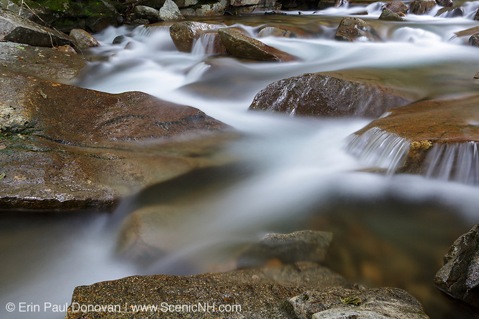 """Franconia Notch State Park - The Pemigewasset River in the area of """"The Basin"""" viewing area in Lincoln, New Hampshire uring the spring months."""