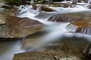 "Franconia Notch State Park - The Pemigewasset River in the area of ""The Basin"" viewing area in Lincoln, New Hampshire uring the spring months."