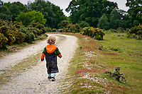 Young boy going for a walk in the countryside.