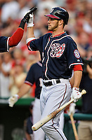 """16 May 2012: Washington Nationals outfielder Bryce Harper gets a """"high-five"""" during a game against the Pittsburgh Pirates at Nationals Park in Washington, DC. The Nationals defeated the Pirates 7-4 in the first game of their 2-game series. Mandatory Credit: Ed Wolfstein Photo"""