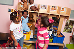 Education Preschool 3-4 year olds two girls playing with doll and puppet