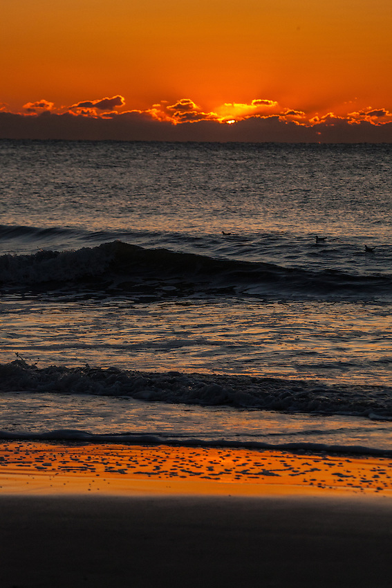 Sunset Reflection on the Sand