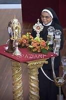 Carry relics of new saints during a canonization mass Pope Francis for Euphrasia Eluvathingal, friar Francescano Amato Ronconi, bishop Antonio Farina, priest Kuriakose Elias Chavara, friar Francescano Nicola Saggio da Longobardi and friar Francescano Amato Ronconi in St Peter's square at the Vatican on November 23, 2014.