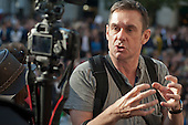 BBC journalist Paul Mason records a report using a DSLR camera. Occupy the London Stock Exchange. Protesters gather at St.Pauls Cathedral on a global day of action against corporate greed.