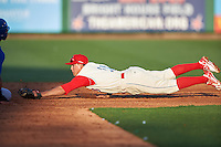 Clearwater Threshers second baseman Scott Kingery (31) dives towards second attempting to tag a runner caught off base during a game against the Dunedin Blue Jays on April 8, 2016 at Bright House Field in Clearwater, Florida.  Dunedin defeated Clearwater 8-3.  (Mike Janes/Four Seam Images)