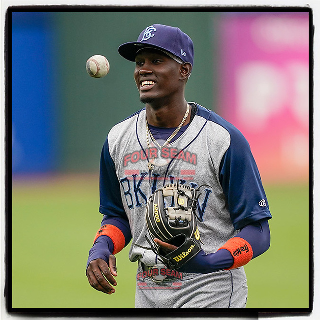Shortstop Ronny Mauricio (2) of the Brooklyn Cyclones tosses a ball during warmups before a game against the Greenville Drive on Wednesday, May 12, 2021, at Fluor Field at the West End in Greenville, South Carolina. (Tom Priddy/Four Seam Images)