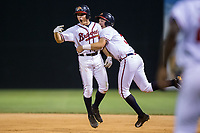 Bradley Keller (left) of the Danville Braves is grabbed by teammate Drew Lugbauer (38) after his walk-off hit in the bottom of the 11th inning against the Princeton Rays at American Legion Post 325 Field on June 25, 2017 in Danville, Virginia.  The Braves walked-off the Rays 7-6 in 11 innings.  (Brian Westerholt/Four Seam Images)