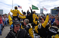 .#10 SunTrust Pontiac/Riley team celebrates as they head for Victory Lane