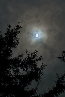 Moon through clouds at night<br />