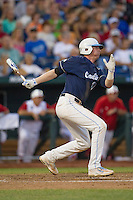 North Carolina third baseman Colin Moran (18) follows through on his swing during Game 10 of the 2013 Men's College World Series against the North Carolina State Wolfpack on June 20, 2013 at TD Ameritrade Park in Omaha, Nebraska. The Tar Heels defeated the Wolfpack 7-0, eliminating North Carolina State from the tournament. (Andrew Woolley/Four Seam Images)