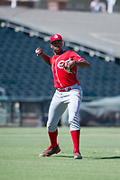 Cincinnati Reds pitcher Hunter Greene (21) makes a throw to first base during an Instructional League game against the Kansas City Royals October 2, 2017 at Surprise Stadium in Surprise, Arizona. (Zachary Lucy/Four Seam Images)