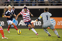 Sydney Leroux (14) of the USWNT tries to move around goalkeeper Gemma Fay (1) of Scotland during the game at EverBank Field in Jacksonville, Florida.  The USWNT defeated Scotland, 4-1.