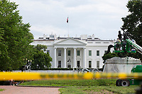 The White House is seen behind caution tape in Washington D.C., U.S., on Thursday, June 11, 2020.  Additional fencing that had been added around the White House due to protests over the death of George Floyd is slowly being removed.  Credit: Stefani Reynolds / CNP/AdMedia