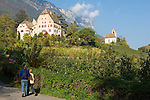 Italy, South tyrol (Alto Adige) Eppan, above district St. Michael is Castle Englar and church St. Sebastian surrounded by vineyards and apple trees at the South Tyrolean Wine Route and Eppan Castle Route
