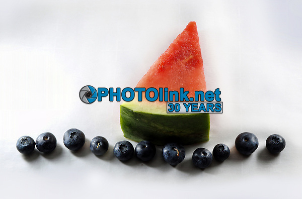 Watermelon sailing in a sea of Blueberries<br /> Photo By Adam Scull/PHOTOlink.net