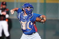 Texas Rangers minor league catcher Charles Moorman #23 during an instructional league game against a Korean All-Star team at the Surprise Stadium Complex on October 13, 2012 in Surprise, Arizona.  (Mike Janes/Four Seam Images)