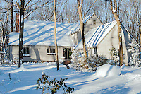Rural house in winter snow.