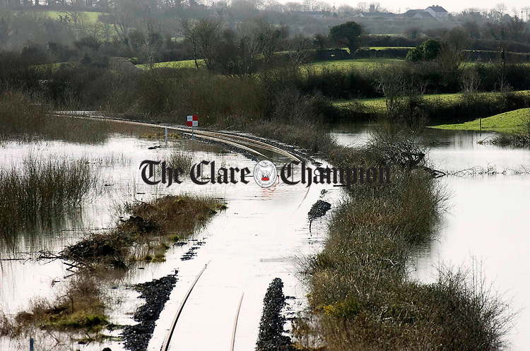 Iarnroid Eireann Permanent Way Inspector Jim Cullinane measures the water depth of a section of flooded tracks between Ennis and Limerick at Ballycar.Pic Arthur Ellis.