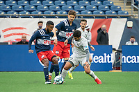 FOXBOROUGH, MA - APRIL 17: Zaca Moran #6 of Richmond Kickers tackles Christian Malfa #38 of New England Revolution II during a game between Richmond Kickers and Revolution II at Gillette Stadium on April 17, 2021 in Foxborough, Massachusetts.
