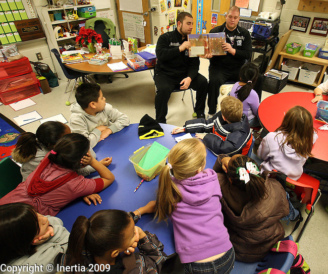 ROME, GA - DECEMBER 17: TJ Wendt, left, and Kyle Staudt, right, of the University of Sioux Falls, read to third grade students at West Elementary School in Rome, GA, on Thursday morning, Dec. 17. The University of Sioux Falls Cougars are in Rome to play Lindenwood University Lions for the NAIA Football Championship on Saturday. (Photo by Dave Eggen/Inertia)